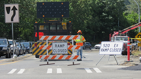 A road closed off with sign saying 'ramp closed'